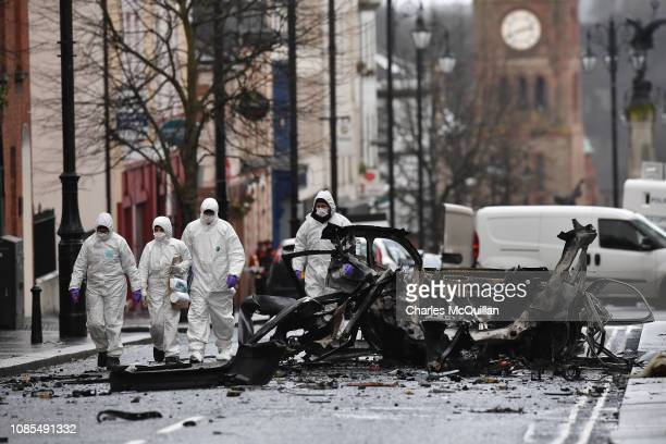 Forensic officers inspect the remains of the van used as a car bomb on an attack outside Derry Court House on January 20 2019 in Londonderry Northern...