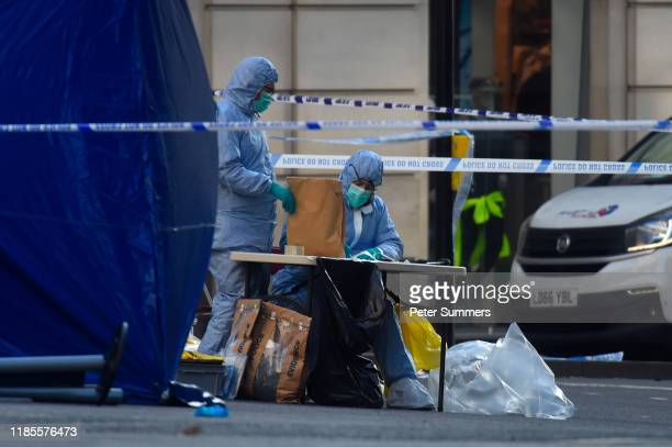 Forensic officers investigate the scene of yesterday's London Bridge stabbing attack on November 30 2019 in London England A man and a woman were...