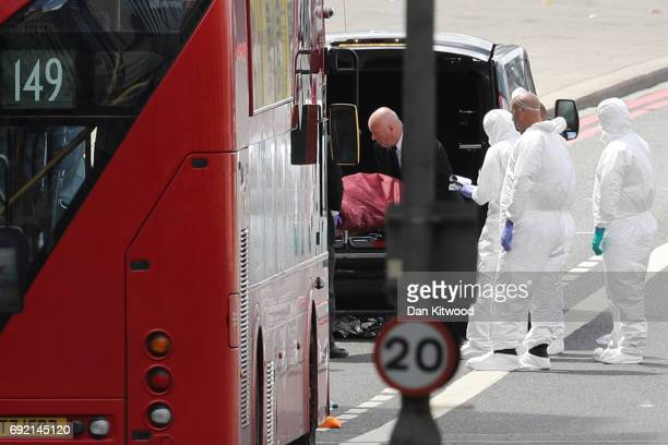 Forensic officers move stretcher into the back of an ambulance on London Bridge after last night's terrorist attack on June 4 2017 in London England...