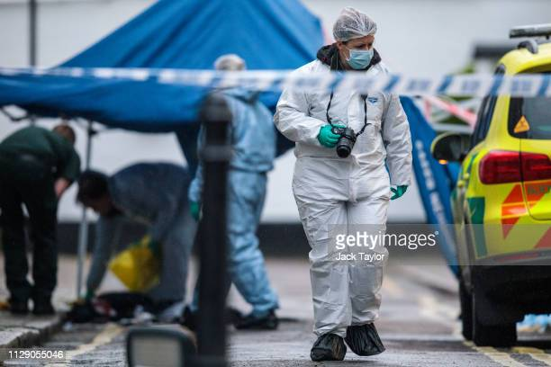 Forensic officers on the scene following a stabbing in West Kensington on March 7 2019 in London England A teenager has reportedly died from his...