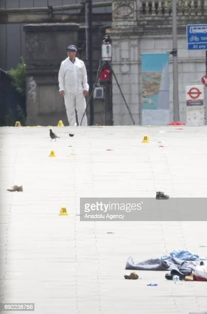 Forensic officers search for evidence across London Bridge following last night terror attack at London Bridge and Borough Market central London...