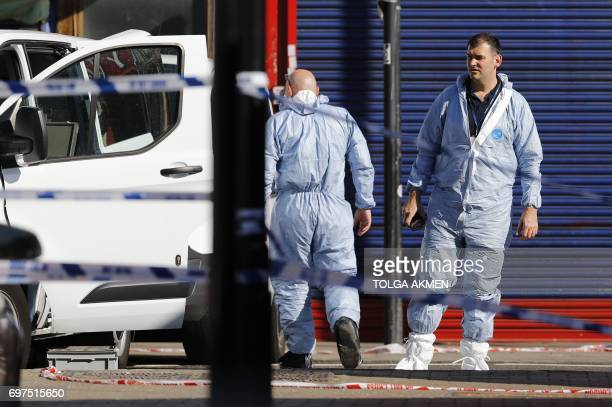 Forensic officers work at the scene in Finsbury Park area of north London after a vehichle hit pedestrians on June 19 2017 A van ploughed into...