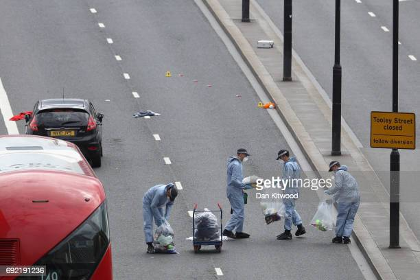 Forensic officers work at the scene on London Bridge following last night's terrorist attack on June 4 2017 in London England Police continue to...