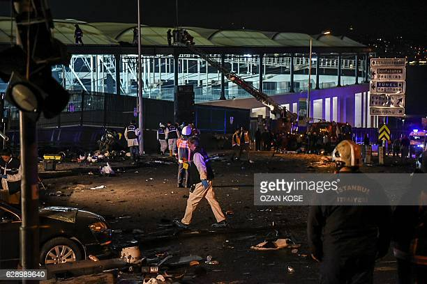 Forensic officers work at the site where a car bomb exploded near the stadium of football club Besiktas in central Istanbul on December 10 2016...