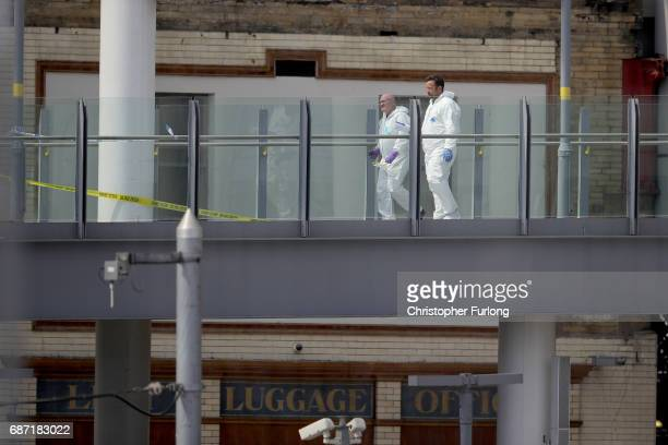 Forensic officers work on a walk walk way connecting the box office of Manchester Arena and Victoria Station after last nights terrorist attack May...