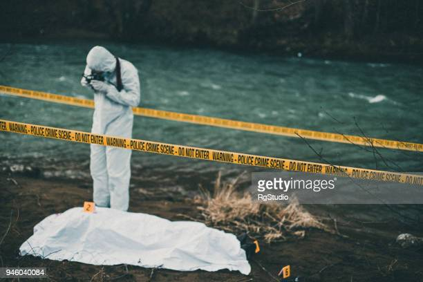 forensic pathologist taking photos of evidence - criminal investigation stock pictures, royalty-free photos & images