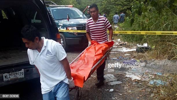 Forensic personnel and policemen recover the corpses of catholics priests Alejo Nabor Jimenez Juarez and Jose Alfredo Juarez de la Cruz who were...