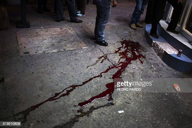 TOPSHOT Forensic personnel inspect the scene where a woman was murdered in Acapulco Guerrero State Mexico on April 6 2016 Guerrero is one of Mexico's...