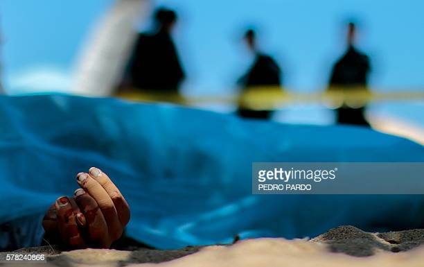 Forensic personnel work by the body of a murdered man in Papagayo Beach in Acapulco Mexico on July 18 2016 With a population of 810000 the touristic...