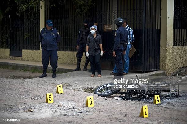 Forensic personnel work on the scene where an alleged gang member was killed by the police after a shooting at El Pedregal neighborhood in...