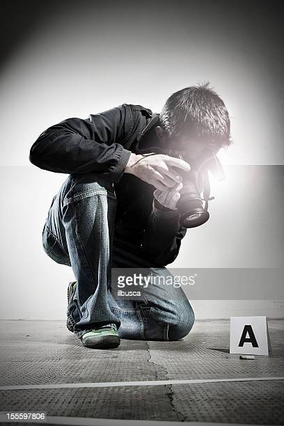 Forensic Photographer at Crime Scene
