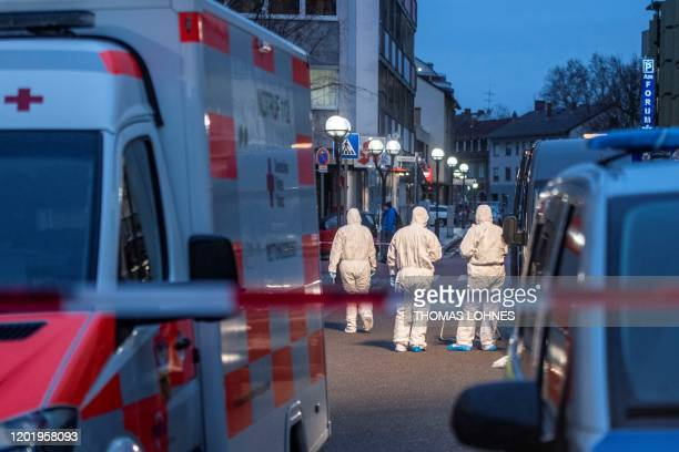 Forensic police are seen at a crime scene in front of a bar and a shisha bar at the Heumarkt in the centre of Hanau near Frankfurt am Main western...