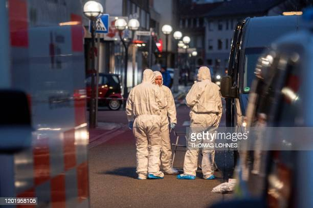 Forensic police are seen at the crime scene in front of a bar and a shisha bar at the Heumarkt in the centre of Hanau near Frankfurt am Main western...