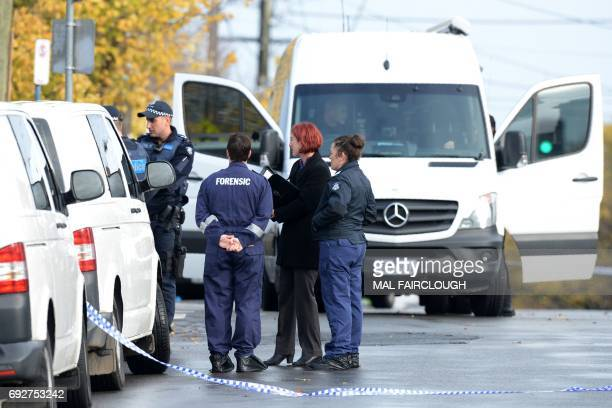 Forensic police are seen at the scene of a shootout in the Melbourne bayside suburb of Brighton on June 6 2017 A fatal shootout claimed by the...