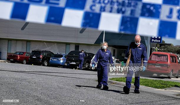 Forensic police are seen at the scene where a man as shot dead after stabbing two counter terrorism officers in the suburb of Endeavour Hills on...