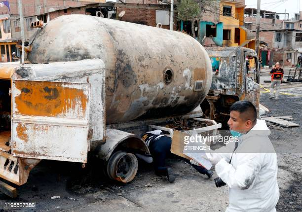 Forensic police inspect the wreckage of a gas tanker that exploded in Lima on January 23 2020 At least two people were killed and dozens injured some...