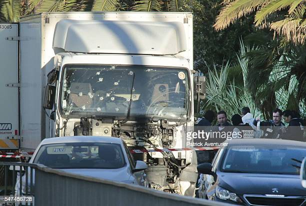 Forensic police investigate a truck at the scene of a terror attack on the Promenade des Anglais on July 15 2016 in Nice France A FrenchTunisian...