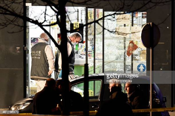 Forensic police investigate the scene at the Hyper Cacher kosher grocery store near Porte de Vincennes in eastern Paris on January 9 2015 after...