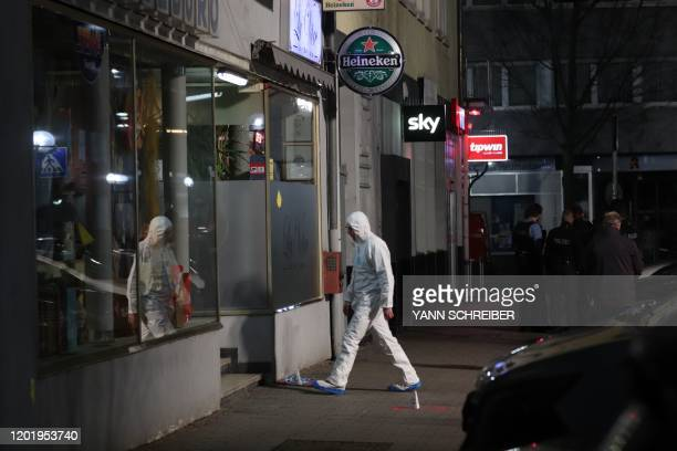 Forensic police investigates the scene of a shooting in Hanau western Germany on February 20 2020 At least eight people were killed in two shootings...