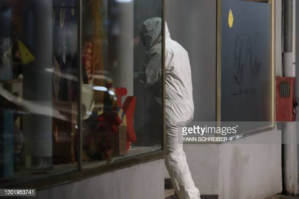 Forensic police investigates the scene of a shooting in Hanau, western Germany, on February 20, 2020. - At least eight people were killed in two...