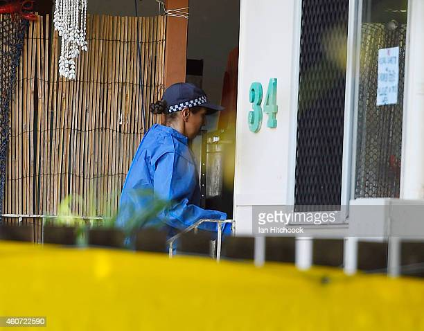 Forensic police officer walks into the home of a multiple stabbing in the suburb of Manoora on December 21 2014 in Cairns Australia Eight children...