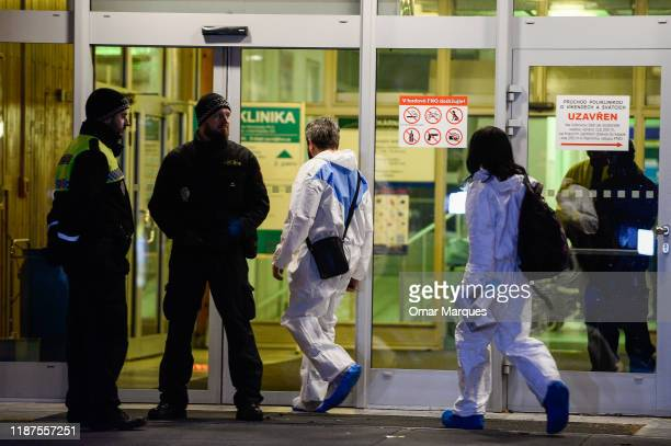 Forensic Police officers arrive at the Ostrava Teaching Hospital after a shooting incident on December 10, 2019 in Ostrava, Czech Republic. A gunman...