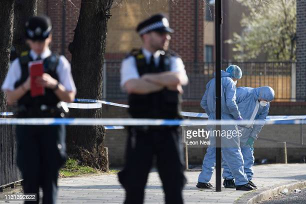 Forensic police officers attend the Marcus Lipton Youth Club in Minet Road southwest London after a 23yearold man was fatally stabbed yesterday on...