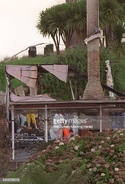 Forensic police officers in the ruins of the Seascape Guesthouse where gunman Martin Bryant retreated after shooting and killing 35 people during the...