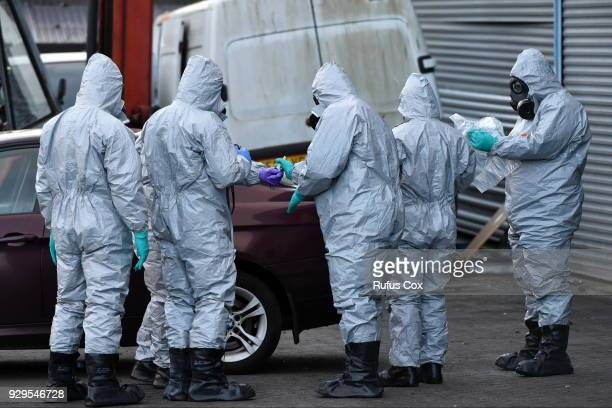 Forensic police officers wearing hazmat suits examine a vehicle believed to belong to Sergei Skripal on March 8 2018 in Salisbury England Police...