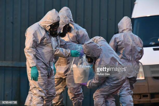 Forensic police officers wearing hazmat suits prepare to examine a vehicle believed to belong to Sergei Skripal on March 8 2018 in Salisbury England...
