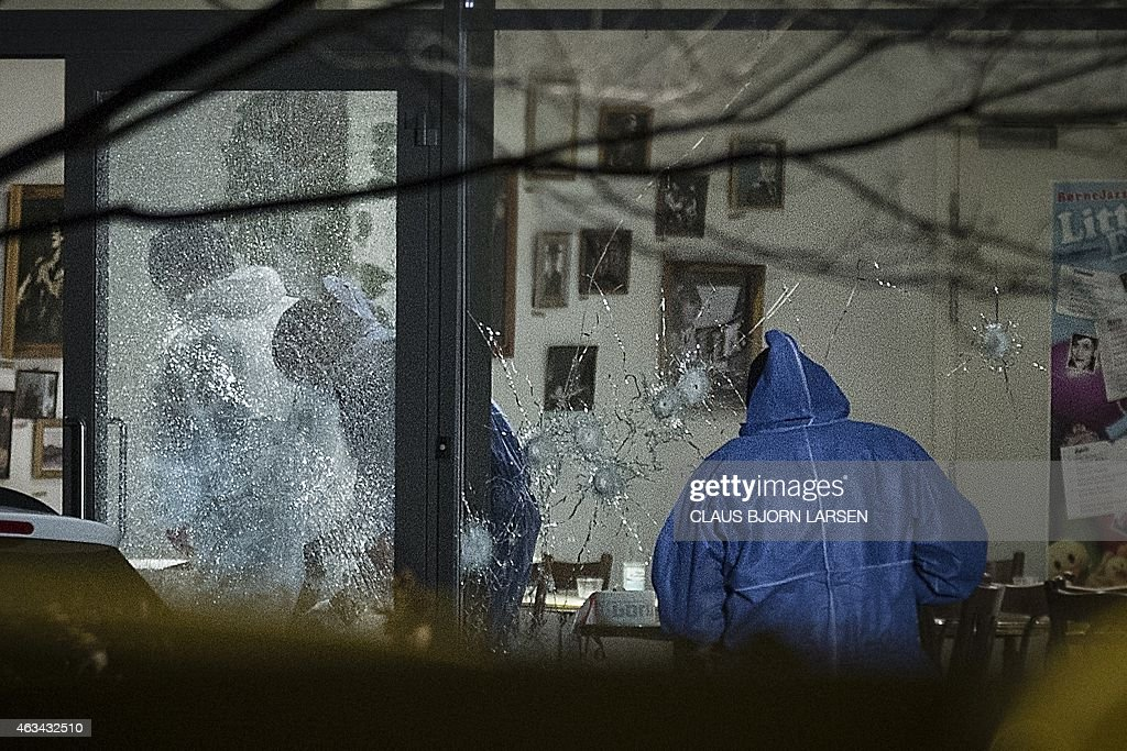 Forensic police officers work at the cultural center Krudttonden in Copenhagen, Denmark, where shots were fired during a debate on Islam and free speech on February 14, 2015. Unidentified gunmen killed at least one person and wounded several police officers after opening fire in what French authorities call 'a terrorist attack'. France's ambassador to Denmark Francois Zimeray, who was attending the debate, told AFP the attackers were seeking to replicate the January 7 assault by jihadists in Paris on satirical newspaper Charlie Hebdo that left 12 dead. LARSEN