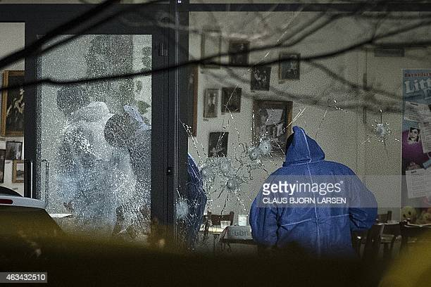 Forensic police officers work at the cultural center Krudttonden in Copenhagen Denmark where shots were fired during a debate on Islam and free...