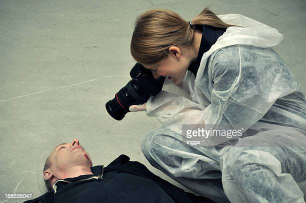 Forensic police photographing dead body