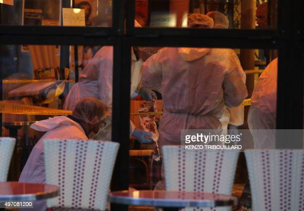 Forensic police search for evidences inside the Comptoir Voltaire cafe at the site of an attack on November 14 2015 in Paris after a series of gun...