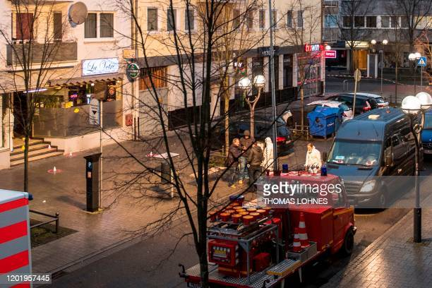 Forensic police work at a crime scene in front of a bar and shisha bar at the Heumarkt in the centre of Hanau near Frankfurt am Main western Germany...
