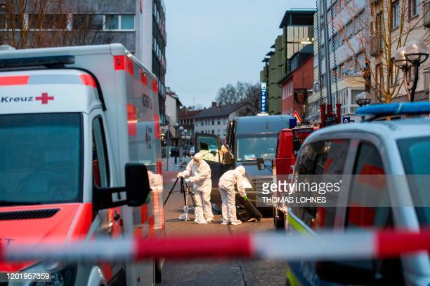 Forensic police work near a crime scene in front of a bar at the Heumarkt in the centre of Hanau near Frankfurt am Main western Germany on February...