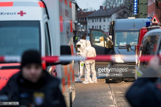 Forensic police work near a crime scene in front of a bar at the Heumarkt in the centre of Hanau, near Frankfurt am Main, western Germany, on...