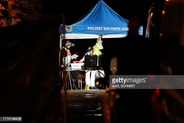 Forensic police work on the site of the shooting in the streets of Halle an der Saale eastern Germany on October 9 after a heavilyarmed man shot two...