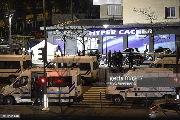 Forensic police work outside the Hyper Cacher kosher grocery store near Porte de Vincennes eastern Paris on January 9 after police launched an...