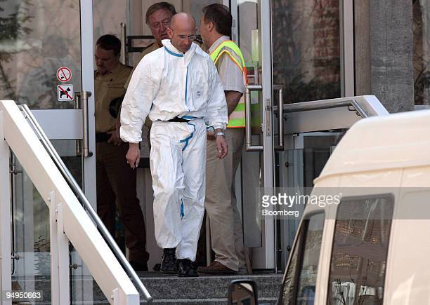 A forensic policeman leaves the regional court the site of a shooting in Landshut Germany on Tuesday April 7 2009 A 60yearold gunman opened fire in a...