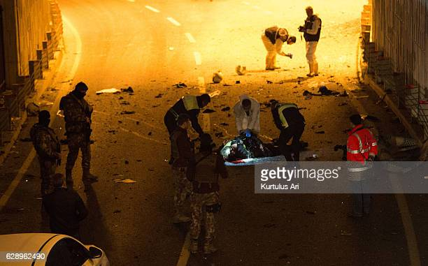 Forensic policemen and officers attend the scene following a twin suicide bomb attack near to Besiktas Vodaphone Arena on December 10 2016 in...