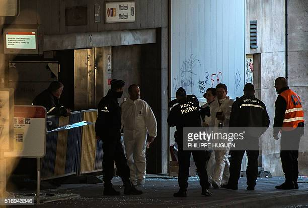 Forensic policemen enter the Maalbeek Maelbeek subway station in Brussels on March 22 after a series of apparently coordinated explosions that ripped...
