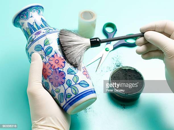 forensic scientist dusting vase for fingerprints. - crime scene stock pictures, royalty-free photos & images