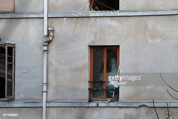 A forensic scientist of the French police searches for evidence in the apartment under the apartment raided by French Police special forces earlier...