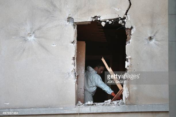 A forensic scientist of the French police searches for evidences in the appartment raided by French Police special forces earlier in the northern...