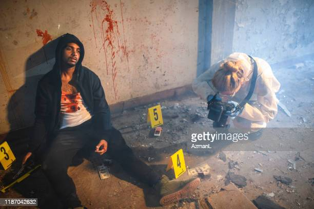 forensic scientist photographing evidence at crime scene - dead person stock pictures, royalty-free photos & images