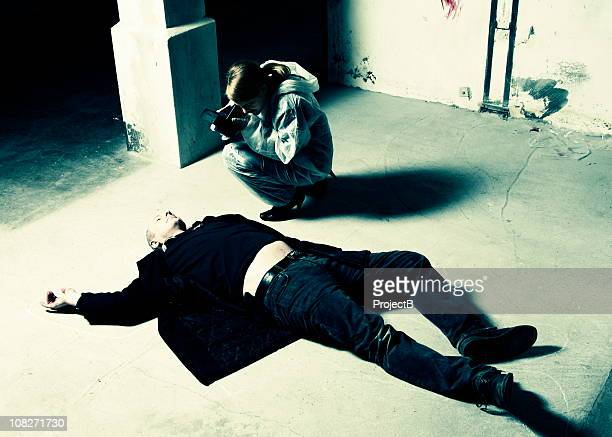 forensic scientist photographs crime scene - dead man stock pictures, royalty-free photos & images