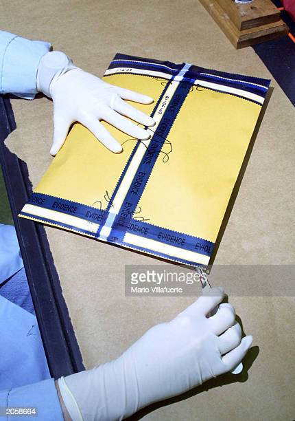 Forensic Scientist prepares open a package containing with clothing connected to a sexual assault case examined at the Louisiana State Police Crime...