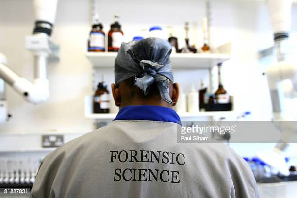 A forensic scientist works during a media open day at the UK Sport Drug Control Centre at King's College on July 10 2008 in London England