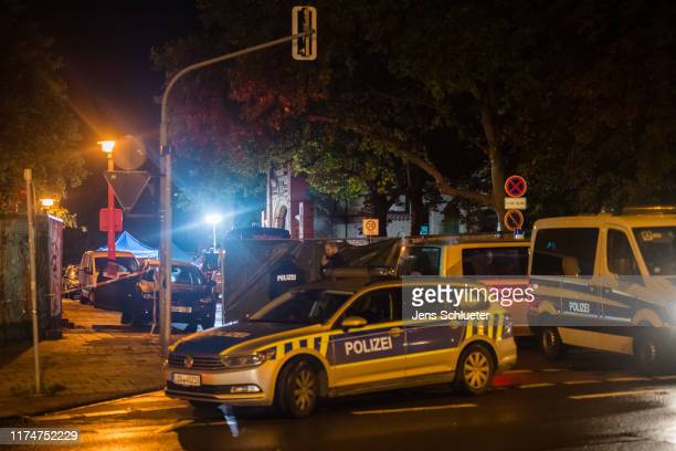 Forensic scientists investigate the crime scene near the scene of a shooting that has left two people dead on October 9 2019 in Halle Germany Law...